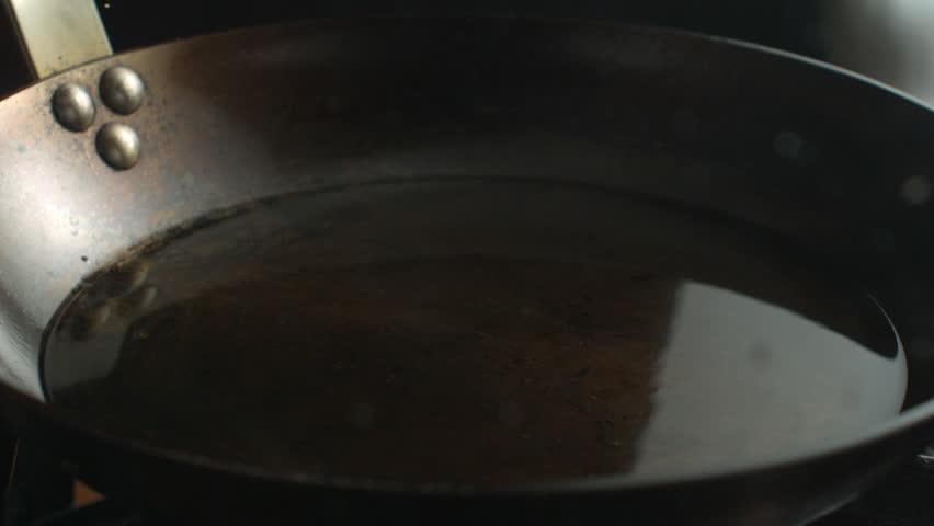 Chicken Breast - Schnitzel Falling on Hot Pan with Oil in Super Slow Motion   Shutterstock HD Video #27350524