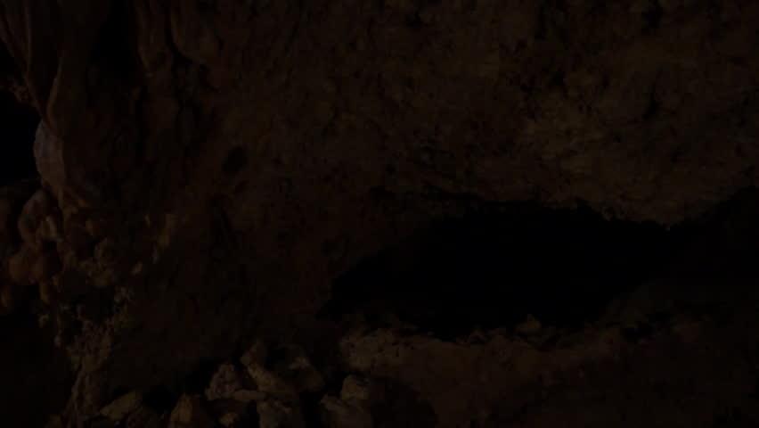 QADISHA VALLEY, LEBANON - CIRCA 2016: Pan-left shot of flowstones on the walls of Qadisha Grotto. The Qadisha River aka Nahr Abu Ali runs through the valley from its source in the Qadisha Grotto. | Shutterstock HD Video #27364789