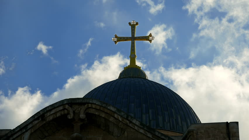 Golden cross over Temple of the Holy Sepulcher church in Jerusalem timelapse. The Holy Sepulchre Church is the most sacred place for all Christians in the world.