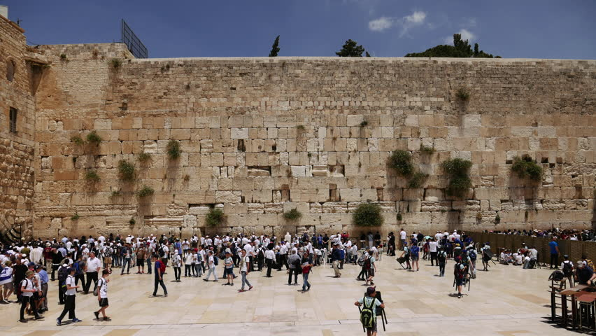 Jerusalem - May 24, 2017: Western Wall or Wailing Wall or Kotel in Jerusalem timelapse. Plenty of people come to pray to the Jerusalem western wall. The Wall is the most sacred place on the planet.