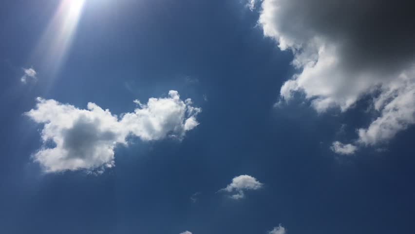 Clouds running across the blue sky. Timelapse cloudscape. Cumulus clouds form against a brilliant blue sky. Timelapse of white clouds with blue sky in background  | Shutterstock HD Video #27373411