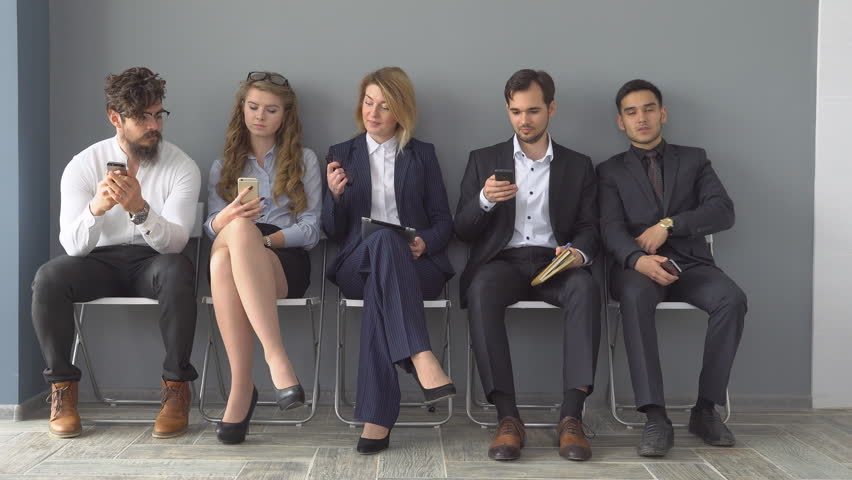 Young applicants are awaiting interview. a group of young people bored waiting for job interview. recruitment to the company. | Shutterstock HD Video #27373975