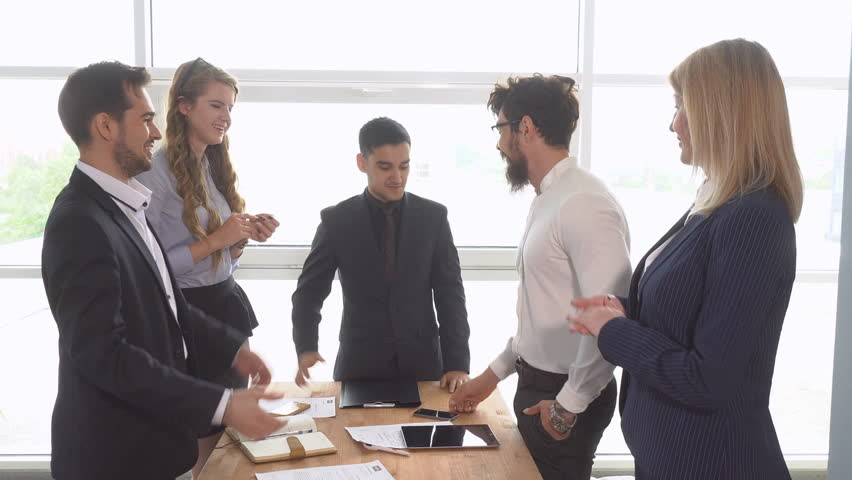 Business meeting. Handshake of businessman at the conclusion of the transaction. Successful negotiations of a group of young businessman in the office of the company | Shutterstock HD Video #27374053