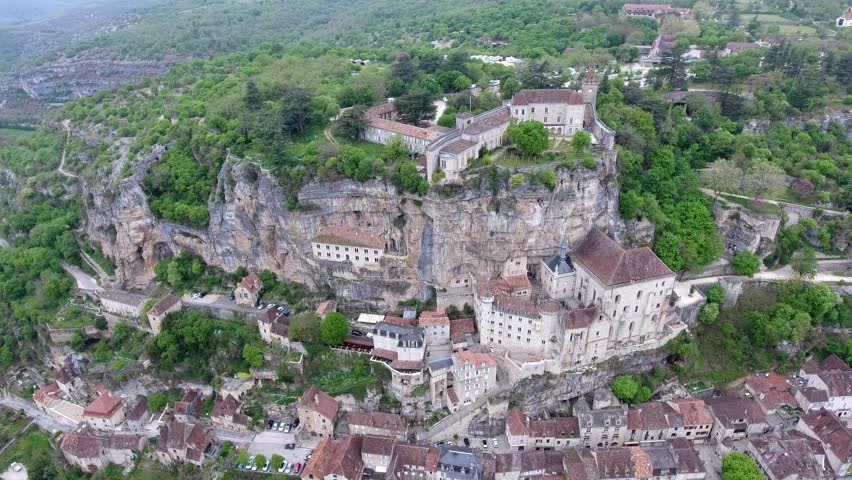 Aerial view. Rocamadour valley: village on hillside, castle on top 3-5 Top interesting point in France: historical monument and sanctuary. The town below the monastic buildings and churches.    Shutterstock HD Video #27386266