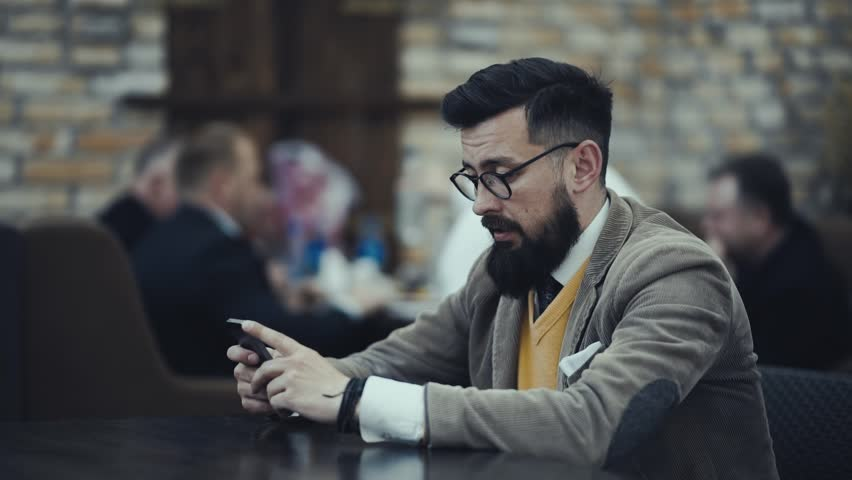 Bearded businessman in glasses bears losses from fatigue rubs his eyes