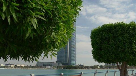 ABU DHABI, UAE - JANUARY 2017: day corniche beach bay nation towers walking panorama 4k circa january 2017 abu dhabi, united arab emirates.