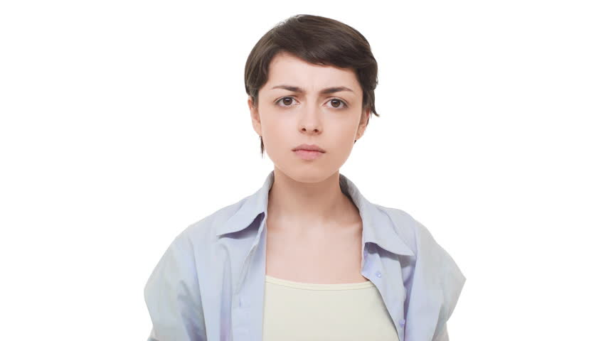Angry beautiful Caucasian female with short dark hair gesturing over white background in dissappointment | Shutterstock HD Video #27397954