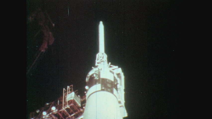 1970s top of apollo rocket. searchlights shine Saturn V on launch pad. men and women in mission control. Richard Nixon in crowd of men and women. rain drops on window. | Shutterstock HD Video #27399781