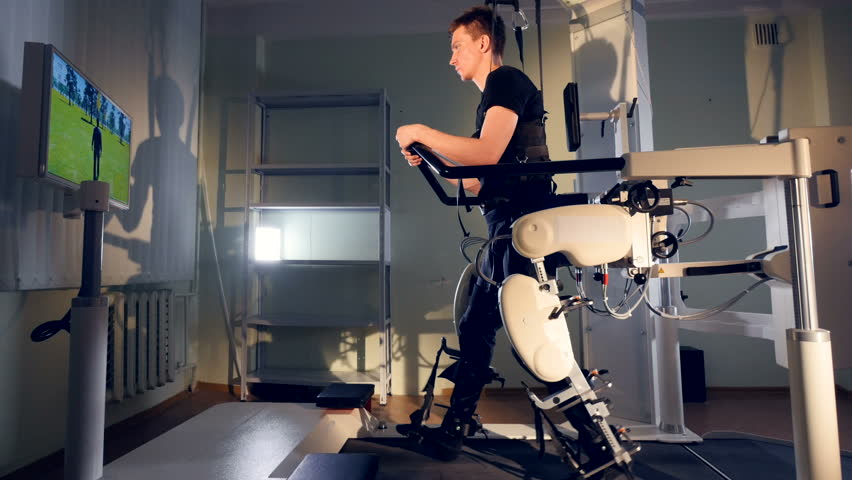 A patient during robot-assisted therapy with the Lokomat device. Royalty-Free Stock Footage #27401362