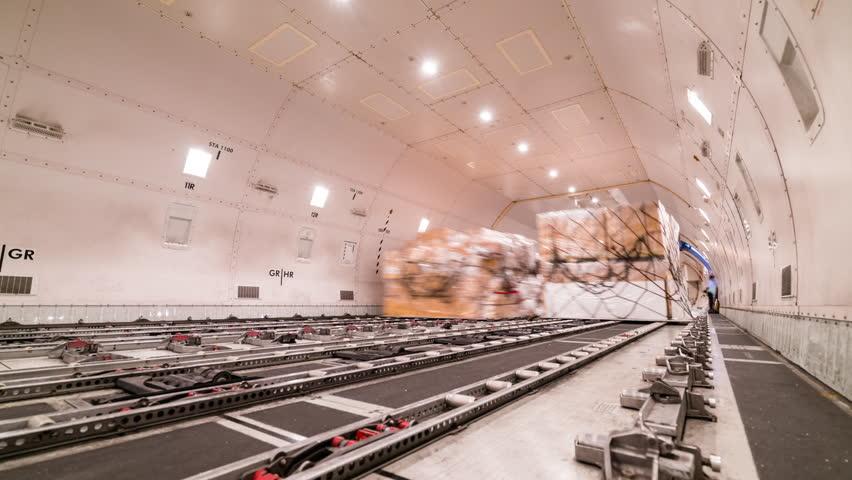 Loading air cargo freighter inside aircraft | Shutterstock HD Video #27427483