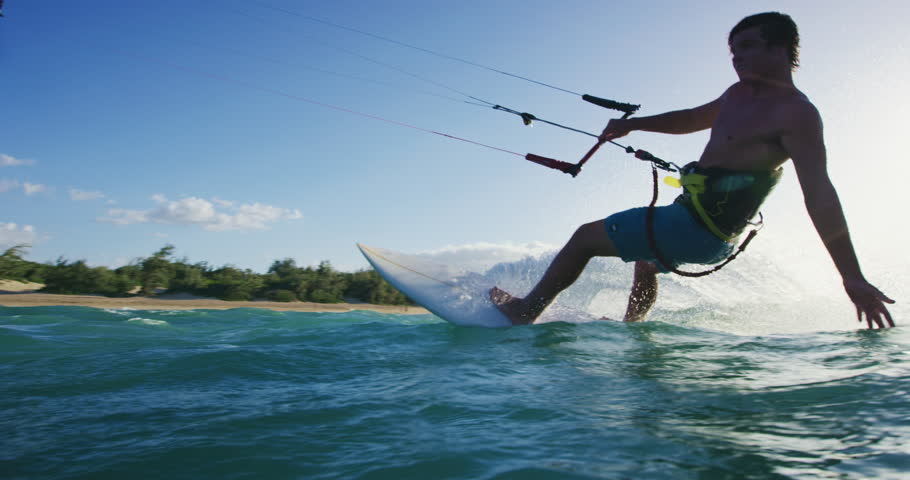 Young man kite surfing. Extreme kite boarding in slow motion. Summer fun action sports. Happiness in nature. Shot on RED #27427768