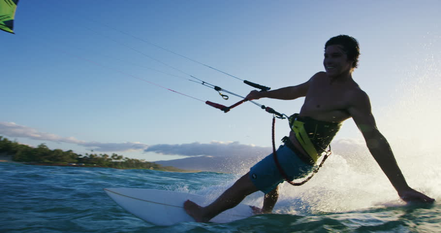 Young man kite surfing. Extreme kite boarding in slow motion. Summer fun action sports. Happiness in nature. Shot on RED   Shutterstock HD Video #27427807