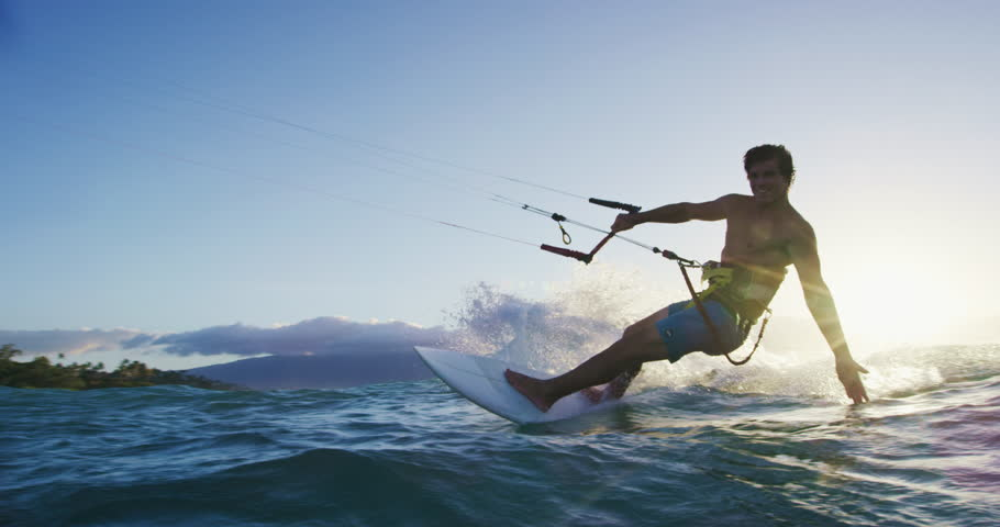 Young man kite surfing. Extreme kite boarding in slow motion. Summer fun action sports. Happiness in nature. Shot on RED | Shutterstock HD Video #27427873