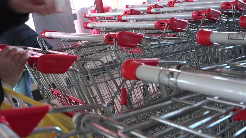 VARNA, BULGARIA - FEB 08, 2012 - Customer and shopping carts at the supermarket | Shutterstock HD Video #27504757
