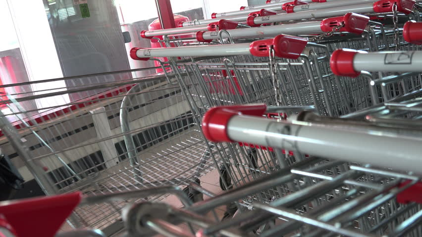 VARNA, BULGARIA - FEB 08, 2012 - Customer and shopping carts at the supermarket | Shutterstock HD Video #27504760