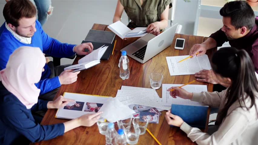 Business people having meeting at table. Covers magazine visible on the video are our project and have proper PR.  | Shutterstock HD Video #27505633
