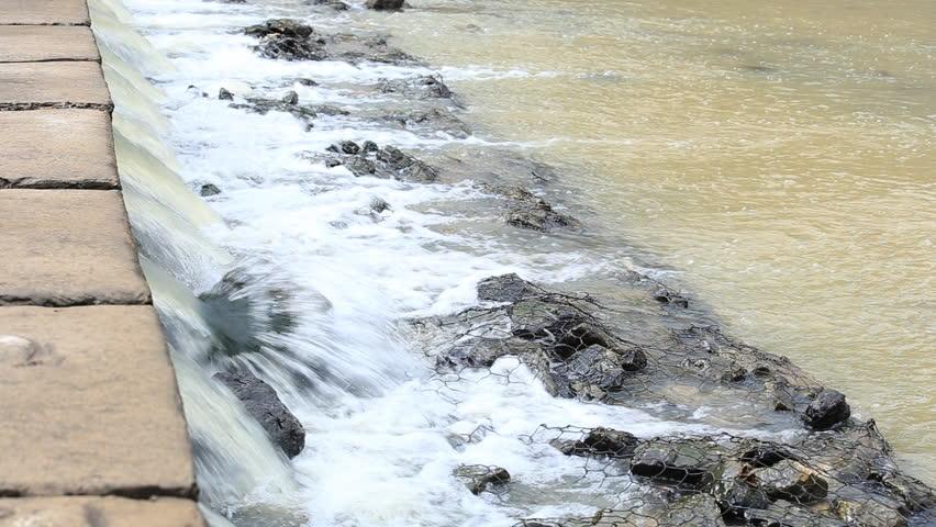 Water flows under pressure at hydroelectric dams.   Shutterstock HD Video #27506242