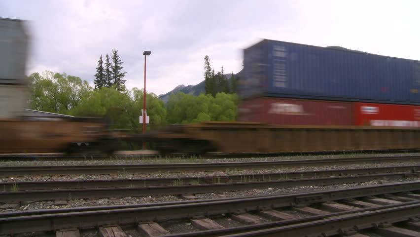 BANFF, CANADA - JUNE 23: An Intermodal freight train passes through Banff National Park on June 23, 2008 in Banff, Canada. Intermodal rail service now comprises a majority freight delivery in Canada.