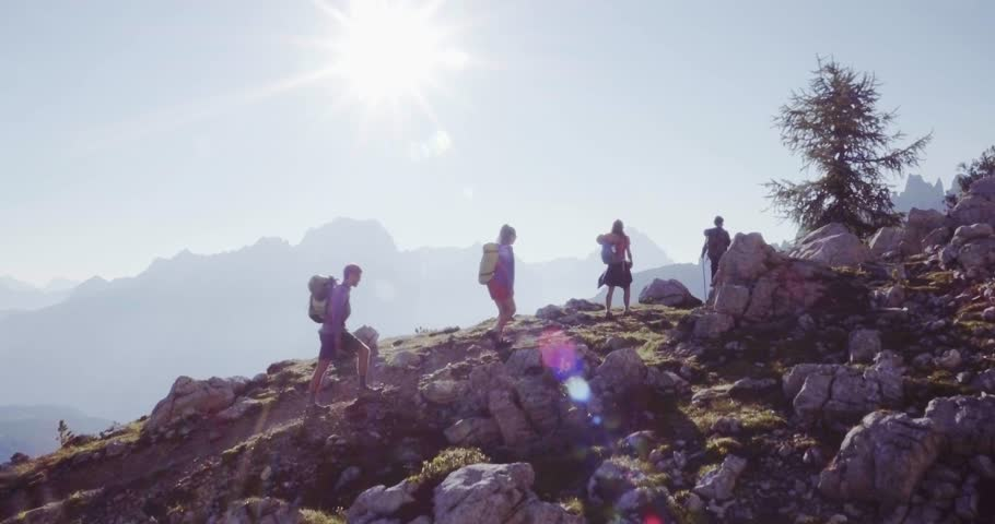 Aerial flight above people hiking along trail path in sunny day. Group of friends summer adventure journey in mountain nature outdoors. Travel exploring Alps, Dolomites, Italy. 4k drone forward video | Shutterstock HD Video #27553543