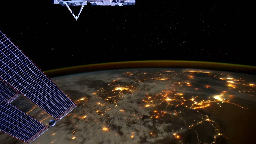 Planet Earth at night seen from the ISS. Elements of this video furnished by NASA. | Shutterstock HD Video #27561655