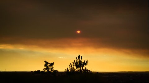Dramatic sunrise time lapse. Forest fire smoke.