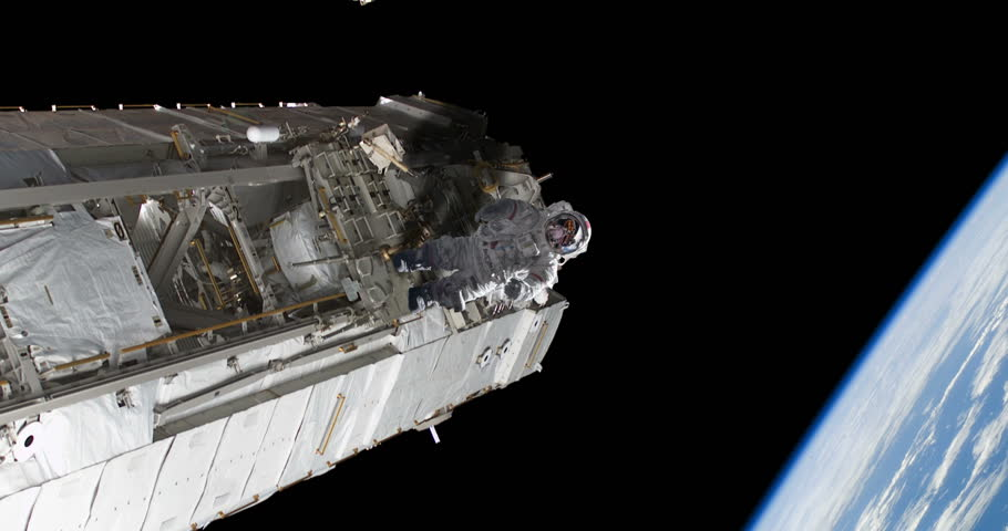 Astronaut Spacewalker Pushing off Space Station Floating Over Earth some elements furnished by NASA images #27575659