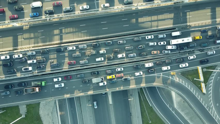 Aerial top down shot of a traffic jam on a car road intersection in the rush hour. 4K video