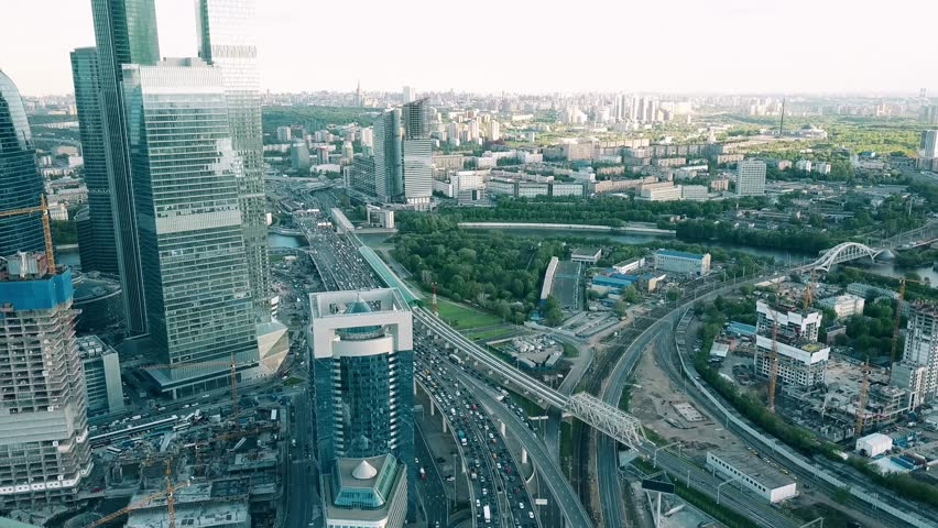 MOSCOW, RUSSIA - MAY, 22, 2017. Aerial time lapse tilt shot of heavy traffic jam in the business district in the rush hour. 4K video | Shutterstock HD Video #27579481
