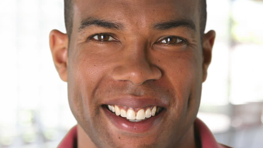Closeup portrait of smiling African American man's face | Shutterstock HD Video #2760329