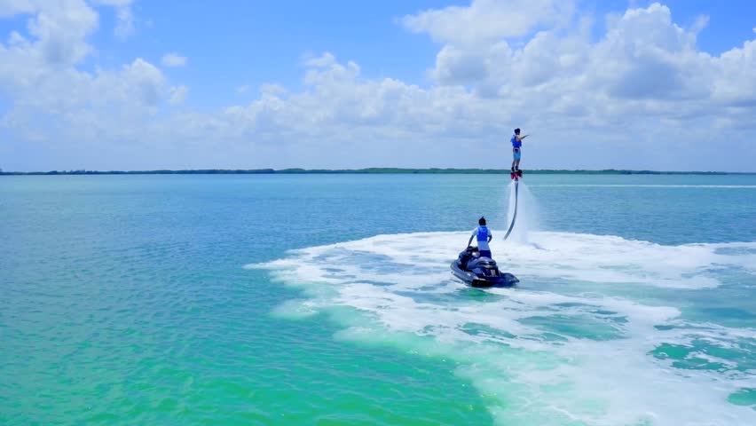 Flyboarding over Blue Water with Jetski