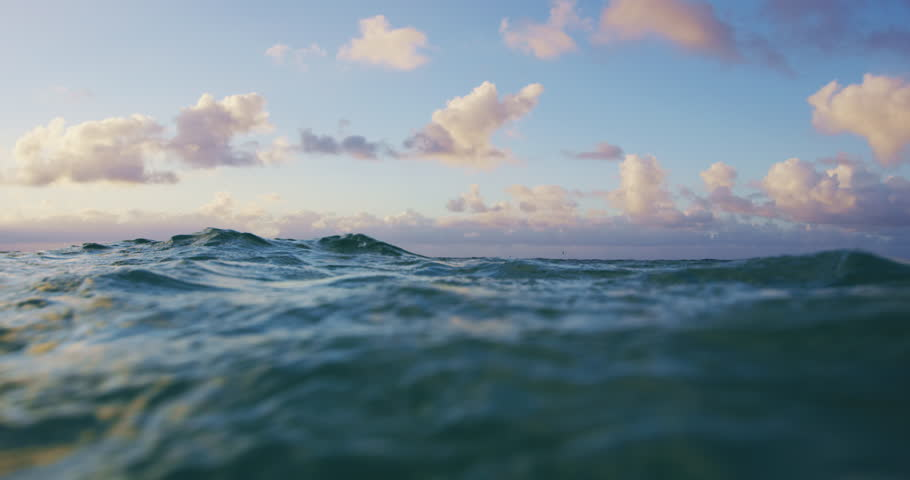 Blue Ocean Surface Waves with Dramatic Sunset Clouds Slow Motion
