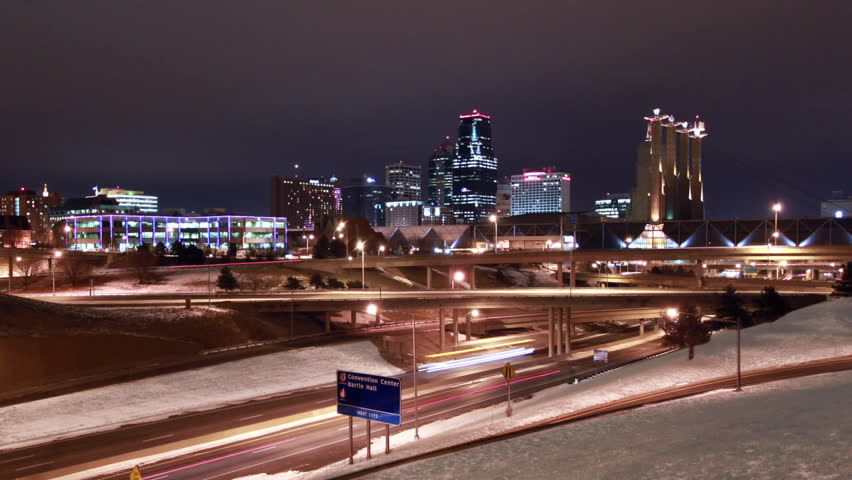 A time-lapse of the Kansas City skyline at night during the inter with heavy snow on the ground