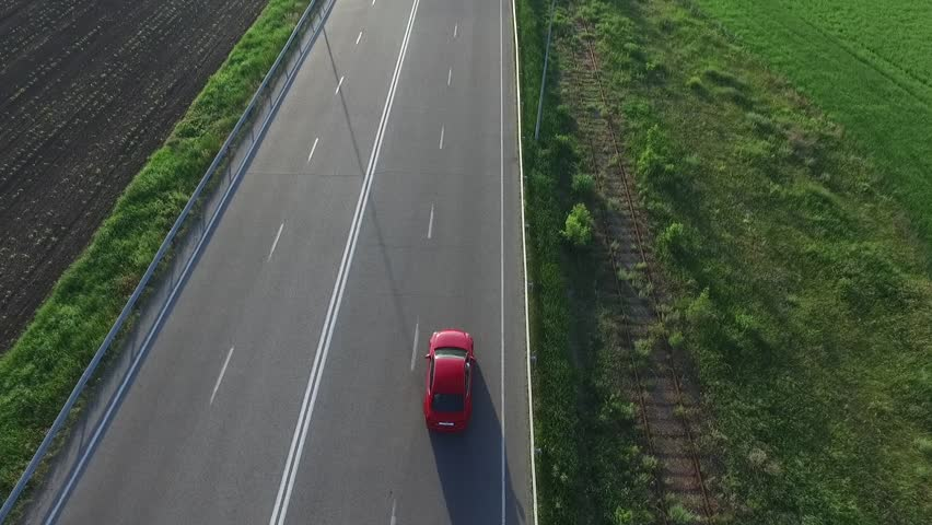 Red car rides on the road, the entry of air, summer   Shutterstock HD Video #27625018