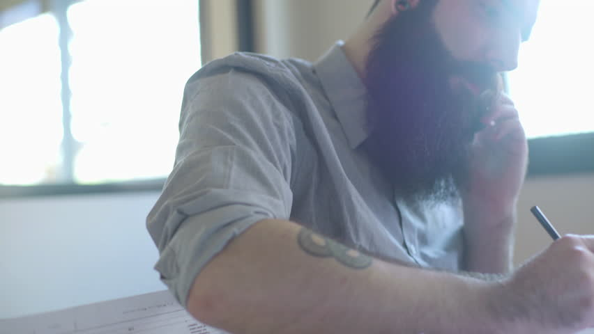 Bearded man talking on cell phone | Shutterstock HD Video #27627688