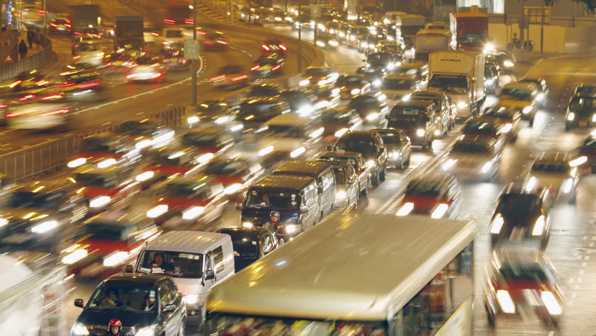 HONG KONG - MARCH 16: Time lapse of Hong Kong city rush-hour traffic at dusk on March 16, 2011 in Hong Kong, China.   Shutterstock HD Video #2764625