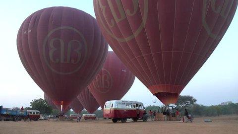Bagan, Myanmar - Feb 17, 2015: Flying balloon service for tourists at sunrise in Bagan, Myanmar.