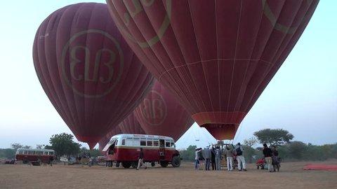 Bagan, Myanmar - Feb 17, 2015: Tourists waiting for flying by air balloons in Bagan, Myanmar.