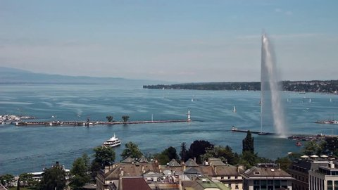 Geneva, Switzerland - June 10, 2016: Jet d'Eau Fountain and the lake with a ship passing by
