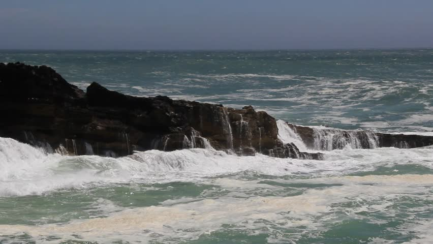 Waves crash on the rocks with violence on a stormy day | Shutterstock HD Video #27682423