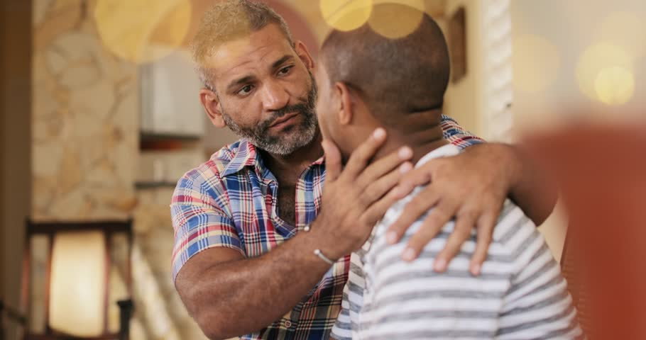 Homosexual couple, gay people, same sex marriage between hispanic men, multiethnic friends, lgbt relationship. Sad partner crying and friend comforting him