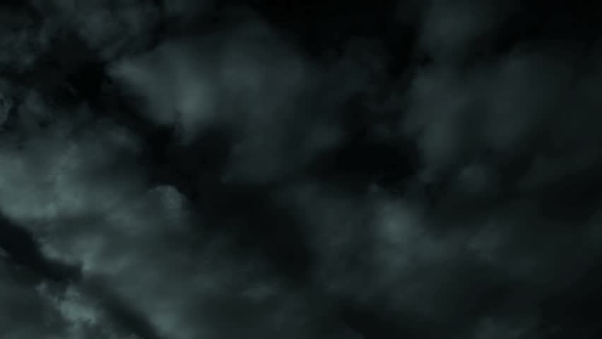 HD - Time lapse clouds travel across a dark nighttime sky. | Shutterstock HD Video #2771705