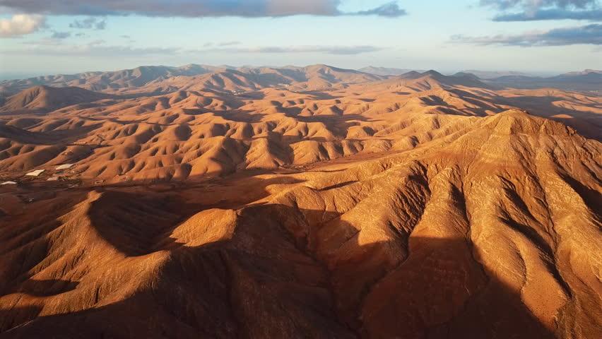 Flight over desert landscape, Fuerteventura island, Spain | Shutterstock HD Video #27728155