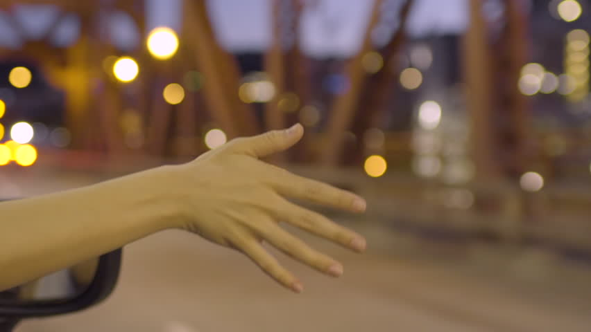 Young Woman Holds Her Hand Out Moving Car Window, Feels The Breeze, On Bridge At Night (Slow Motion) | Shutterstock HD Video #27728317