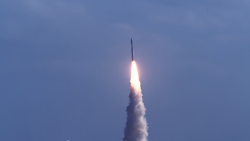 Rocket launch from Cape Canaveral in super slow motion - blue skies and lots of smoke