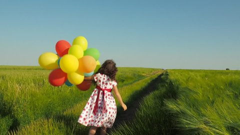 Child with balloons.