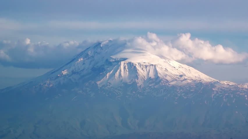 Legendary Ararat mountain, symbol of Armenia, covered by snow, time-lapse, with many clouds