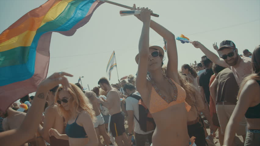 TEL AVIV, ISRAEL - June 9th 2017. Sexy woman holding the pride flag during the pride parade in the city