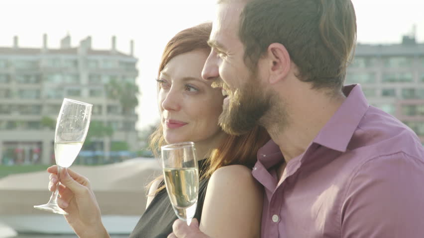 Couple drinking champagne together at waterfront | Shutterstock HD Video #27787060