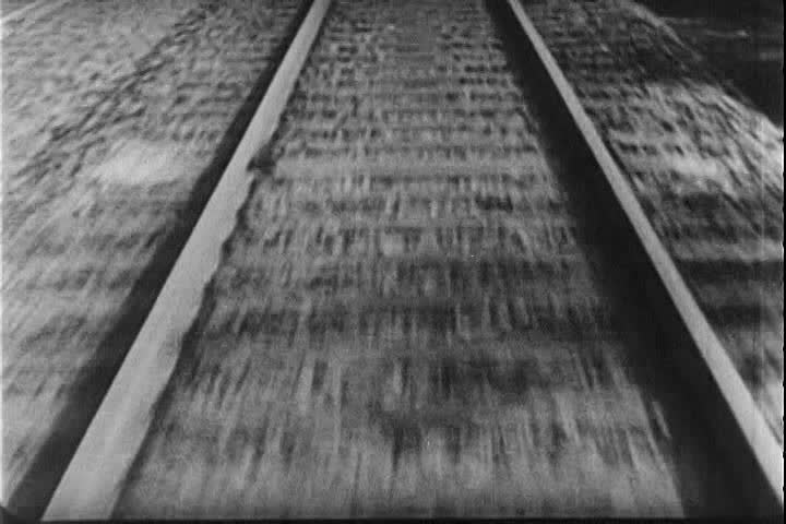 1930s: Construction materials are unloaded from a train into waiting trucks in Nazi Germany in 1939.