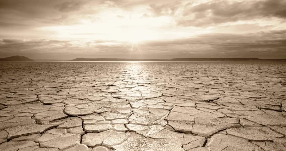 Tracking Sunrise Time Lapse across apocalyptic desert playa wasteland Royalty-Free Stock Footage #27799627